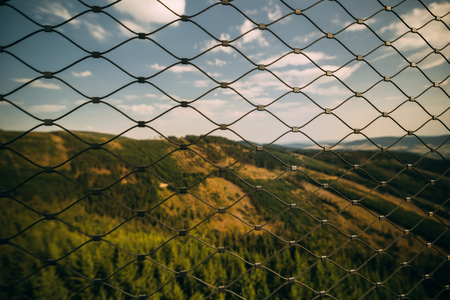 gray chain link fence during daytime