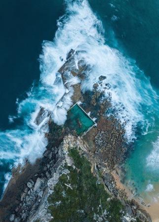 aerial photography of waves splashing on shore