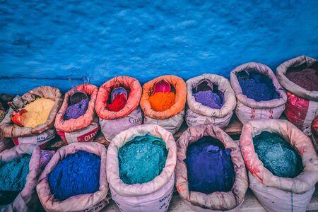 assorted-color powder sock lot beside blue wall Stock fotó