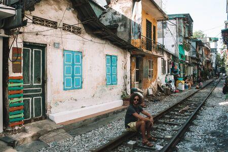 man sitting on train railings 写真素材