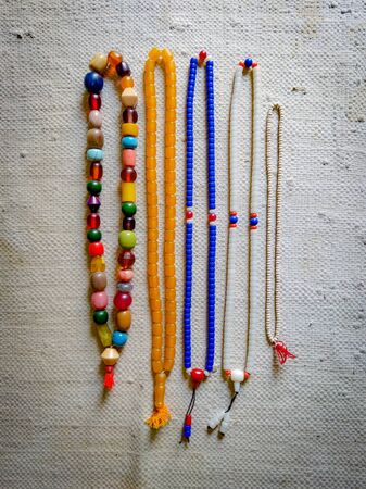 four assorted-color necklaces