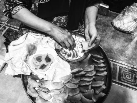 grayscale photo of person preparing foods