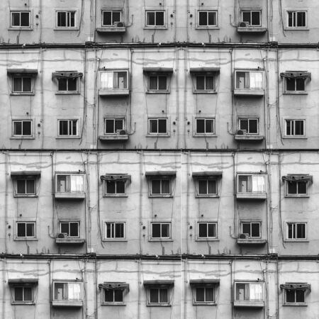 gray concrete building with closed and opened windows Stock fotó