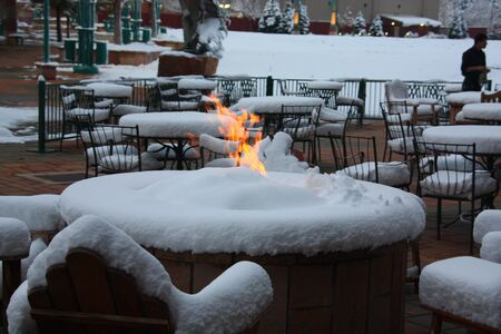 Fire on snowy table