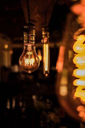 white incandescent light bulb hanging near bulb