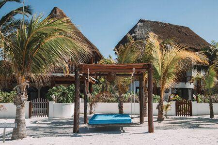 straw huts on beach