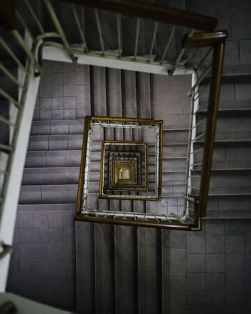 top-view photography of spiral ladder