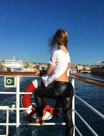 woman leaning on ship railing