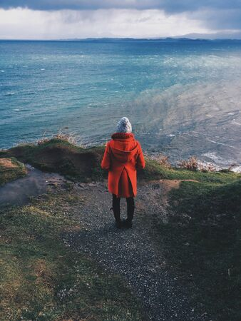person standing beside body of water Stok Fotoğraf