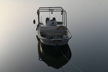 white powerboat on body of water