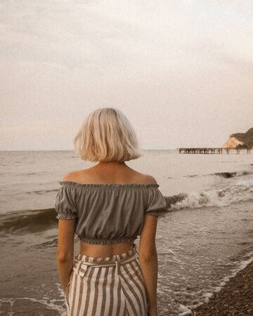 woman looking at body of water