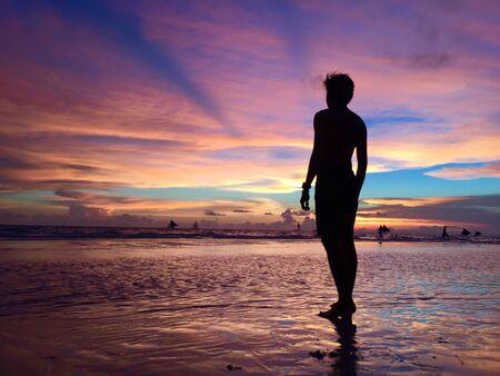 silhouette of man standing near seashore during golden hour Stok Fotoğraf