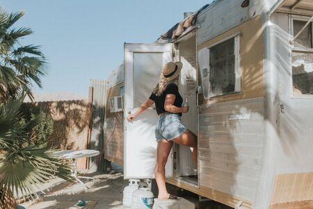 woman standing in front of RV trailer door Imagens