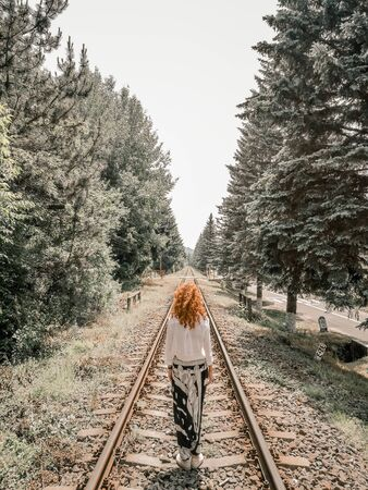woman standing on train rail 免版税图像