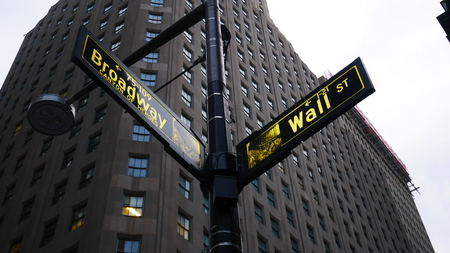 person showing wall street sign Editorial