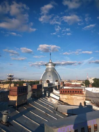 The metal dome above metal rooftops.