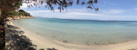 A calm ocean meeting the sandy shore. Banco de Imagens