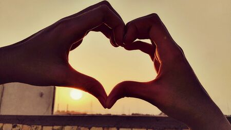 human hand forming heart