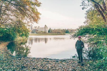 man walking near body of water Stock Photo