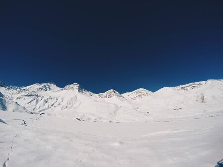 Snow covered mountains during daytime Stok Fotoğraf