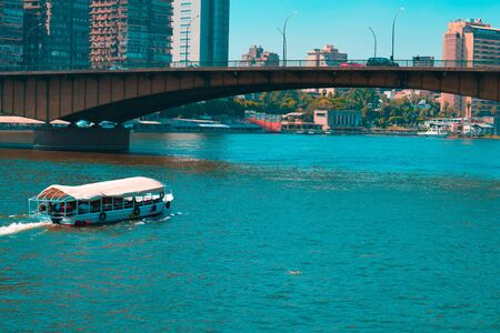 white motorboat near bridge during daytime