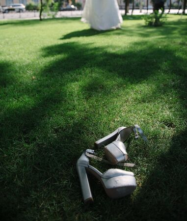 pair of gray peep-toe platform chunky heeled sandals on green grass field during daytime