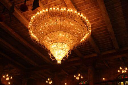 turned on chandelier inside building