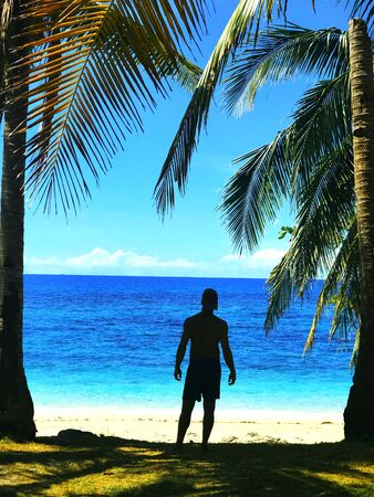 Men standing near beach during daytime