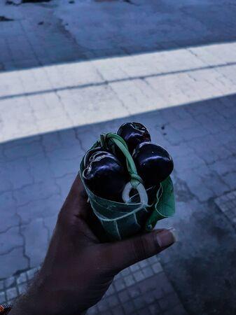 three round black fruits