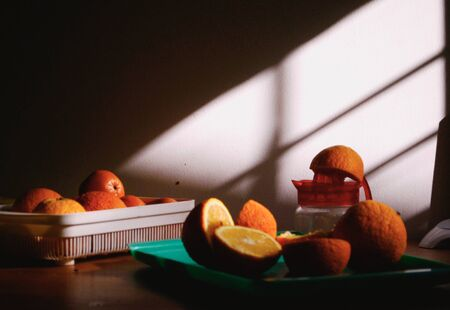 sliced oranges near citrus press