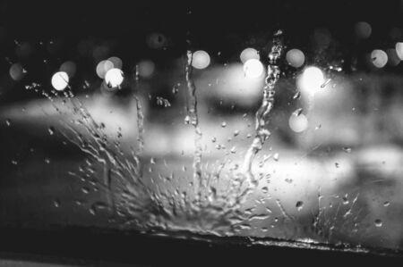 Greyscale photo of liquid on window