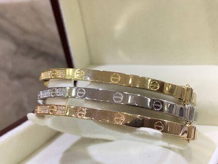 silver and gold bracelets Stok Fotoğraf