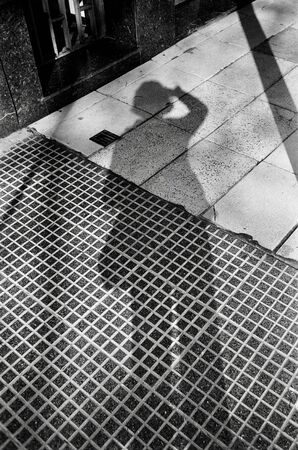 Gray-scale photo of person's shadow Stock Photo