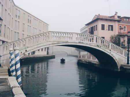 bridge over canal between buildings