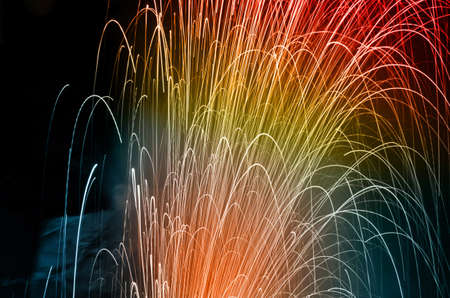 Colorful fireworks of celebration on the dark background photo