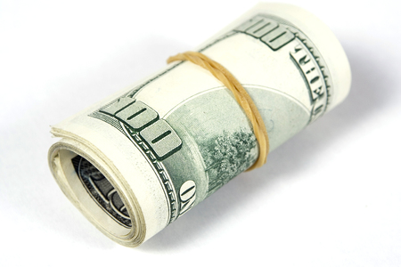 Dollar bills roll. Finance concept