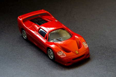 Toy sport car on black background Editorial