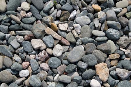 Pebbles on a beach close-up.