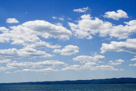 Blue sky over black sea