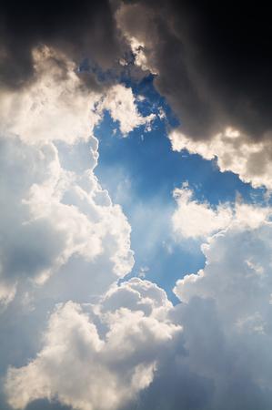 Light window between clouds. Blue sky