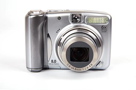 8 megapixel digital camera on isolated white background.