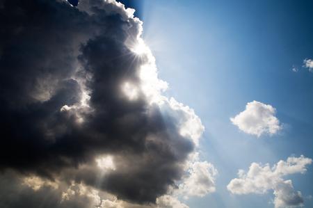 Clouds and Sun. Blue sky. Back light