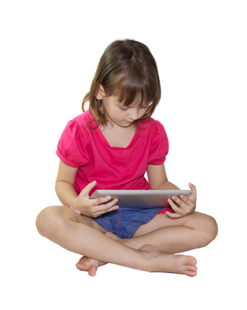 Little girl using tablet on white background photo