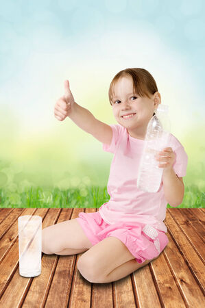 Cute little girl gives the thumbs-up to the camera photo