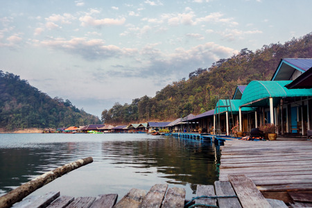 Floating houses on lake in Northern Thailand. Travel background. Text space