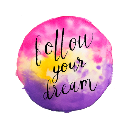 Follow your Dream hand lettering on vibrant pink and yellow watercolor background isolated on white. Inspiration Stock Photo