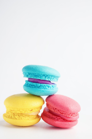 stack of Vibrant colorfull macarons on white wooden table. Text space
