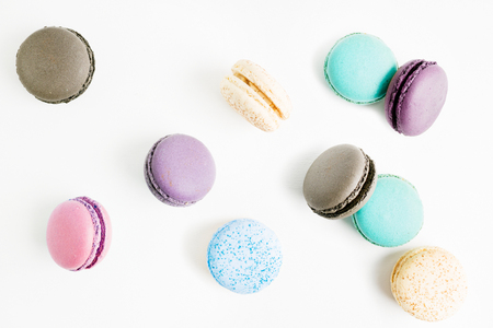 flying Colorful macarons on white background. Minimal pattern, creative dessert concept