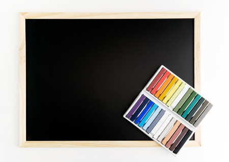 Back chalkboard mockup with colorful chalks on white background. Business, interior design, lettering concept. Text space Archivio Fotografico