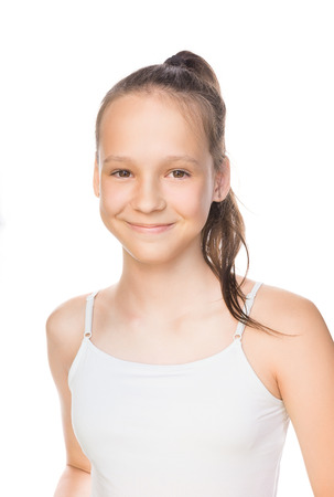 Beautiful smiling caucasian preteen girl in tank top with ponytail isolated on white. Studio portrait